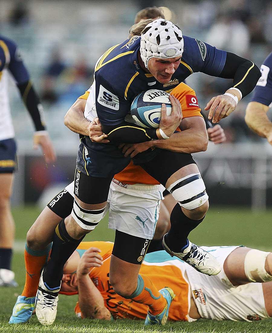 The Brumbies' Ben Mowen breaks a tackle