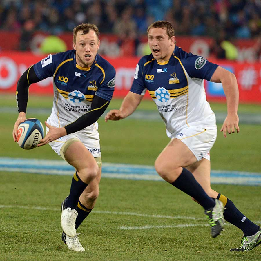 The Brumbies' Jesse Mogg launches an attack against the Bulls