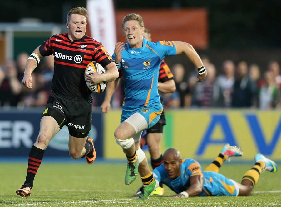 Saracens' Chris Ashton sprints away from Wasps' Tom Howe