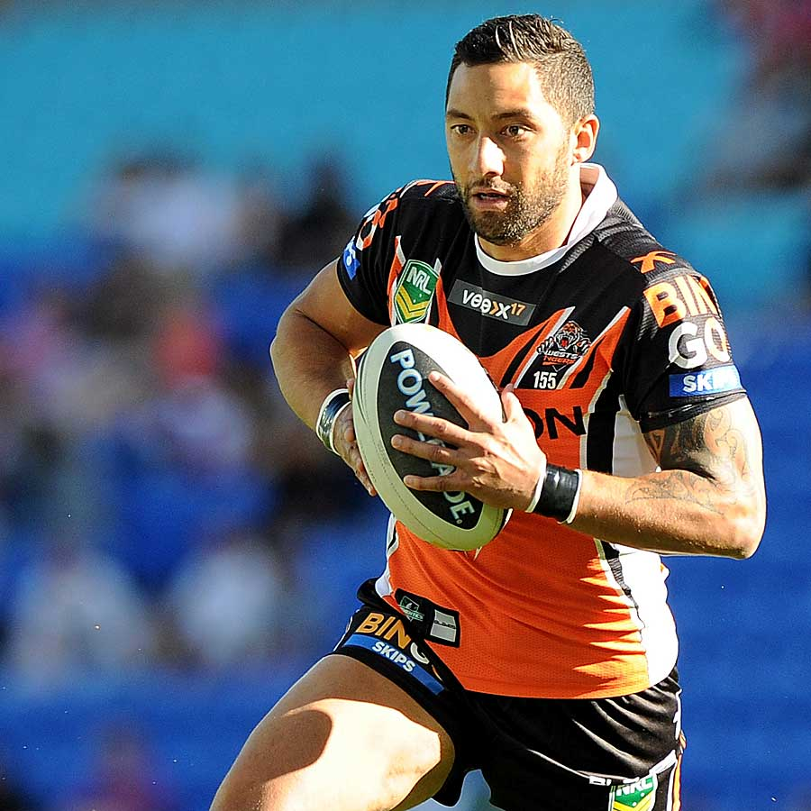 Benji Marshall runs with the ball for Wests Tigers against Gold Coast Titans