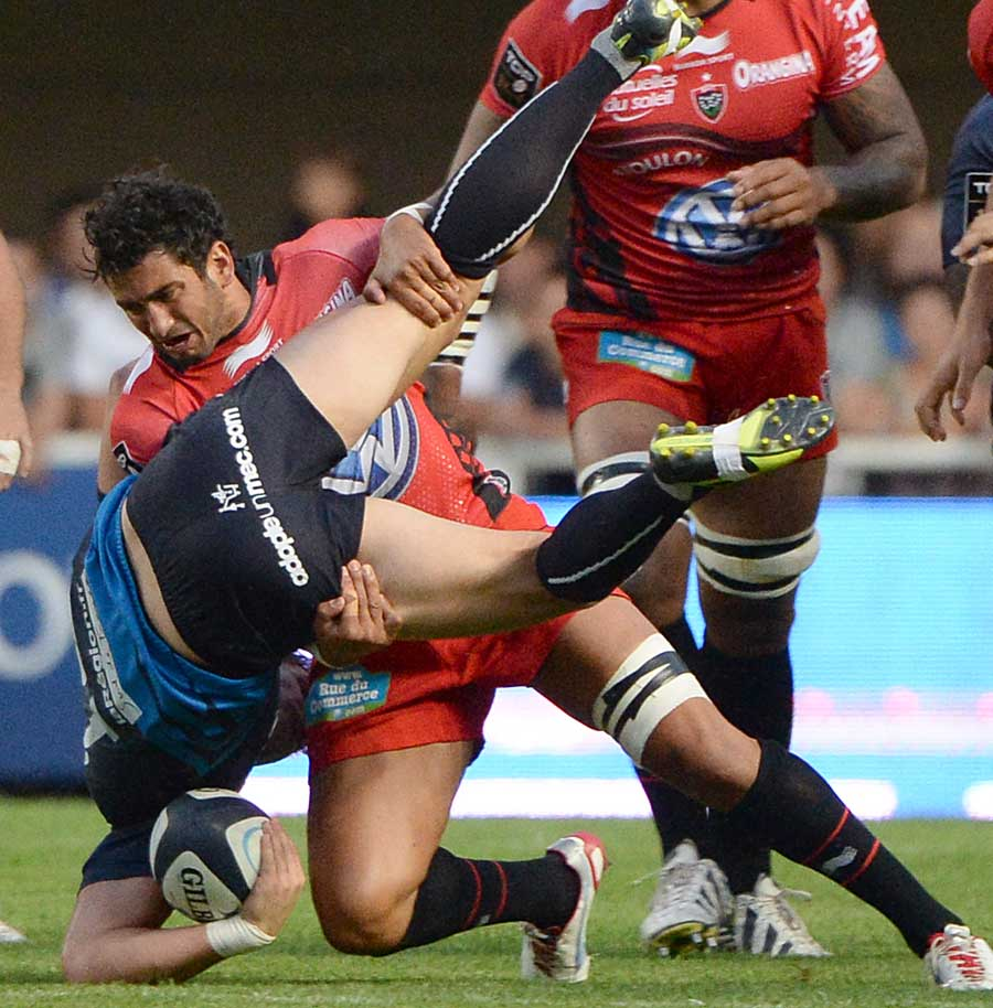 Toulon's Sebastien Tillous-Borde gets to grips with Wynand Olivier