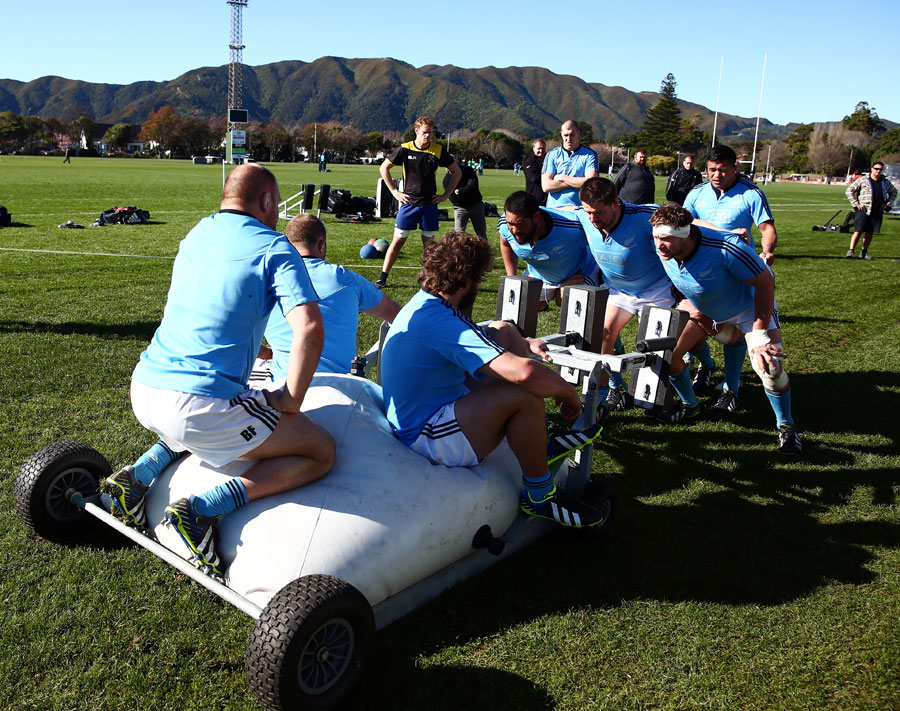 The All Blacks practise scrummaging during a training session