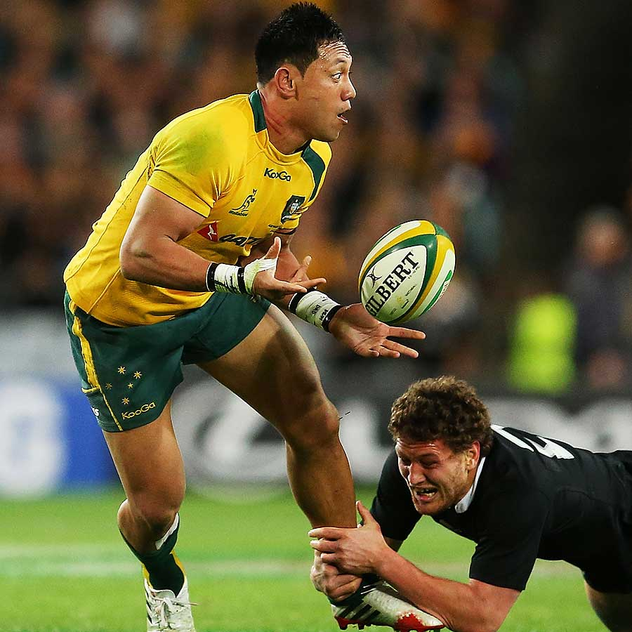 Christian Lealiifano of the Wallabies offloads the ball