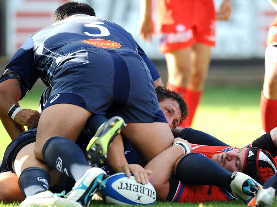 Castres' Brice Mach tries to get the ball out of a ruck