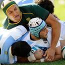 Argentina's Juan Leguizamon scores a try,