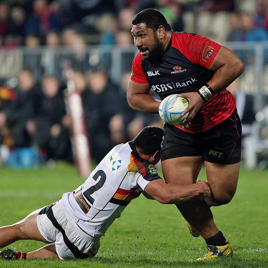 Canterbury's Nepo Laulala beats the tackle of Joe Perawiti