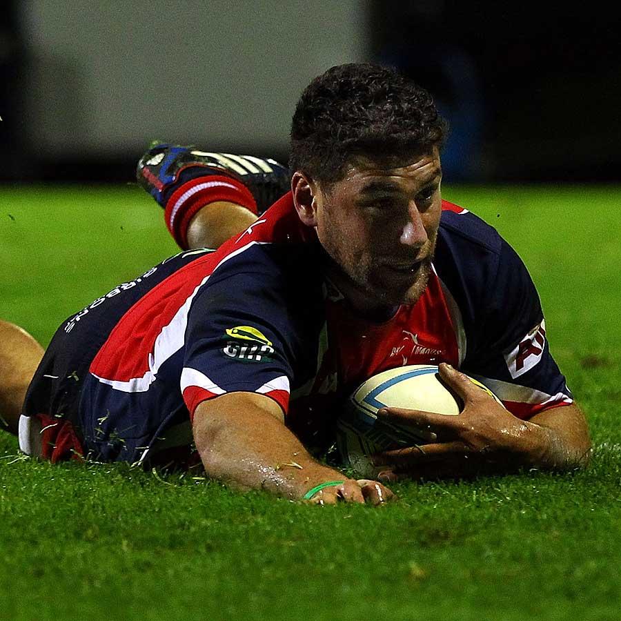 Tasman's Kieron Fonotia scores a try