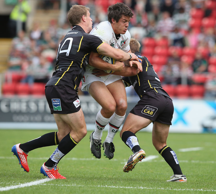 Leicester's Anthony Allen is wrapped up by the Ulster defence