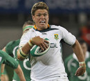South Africa's Juan Smith gallops away from the Irish cover