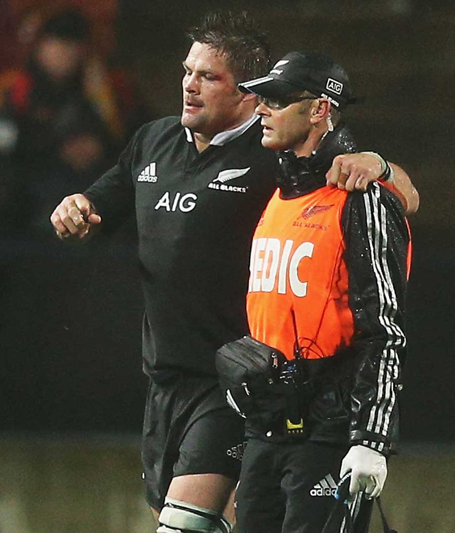 New Zealand's Richie McCaw is helped from the field