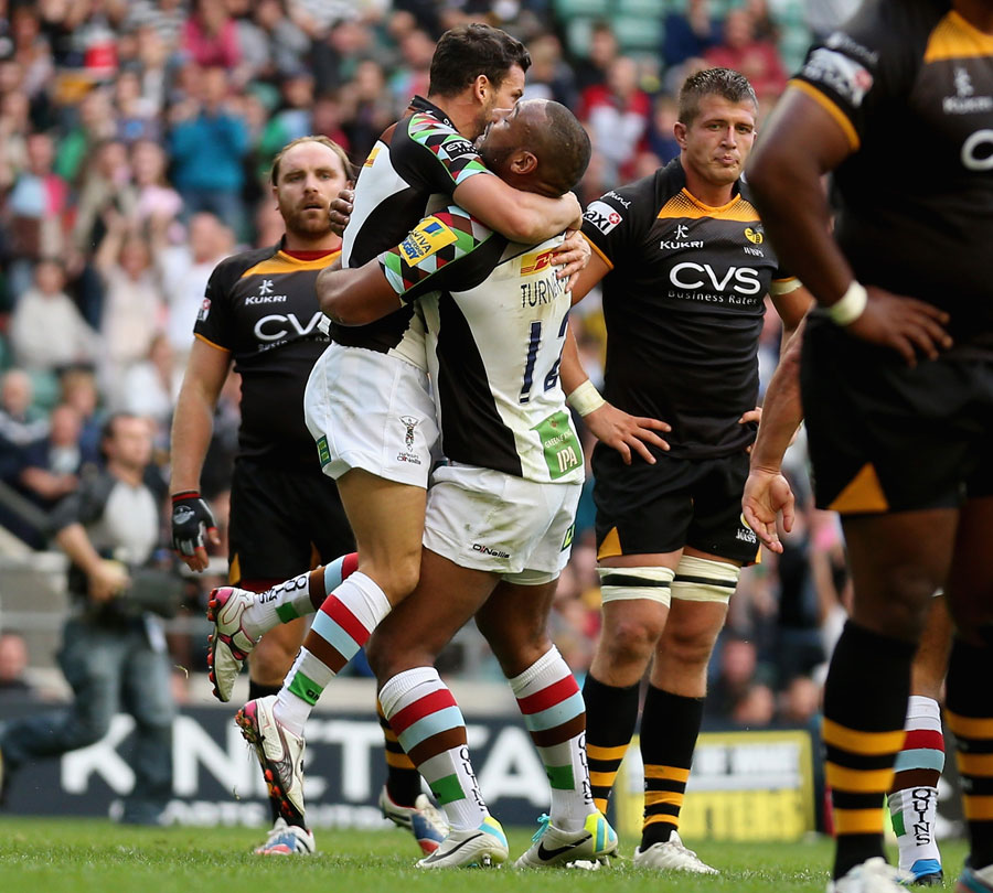 Quins' Karl Dickson is congratulated on a try