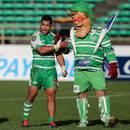 Manawatu's Tevita Taufu'i celebrates victory with the Turbos' mascot