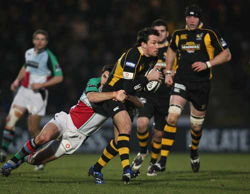 Tom Voyce is tackled by the Harlequins defence