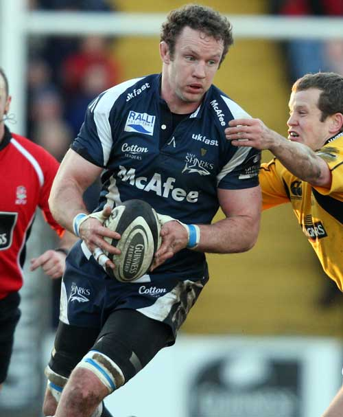Sale Sharks' Jason White is tackled by Wasps' Dave Walder