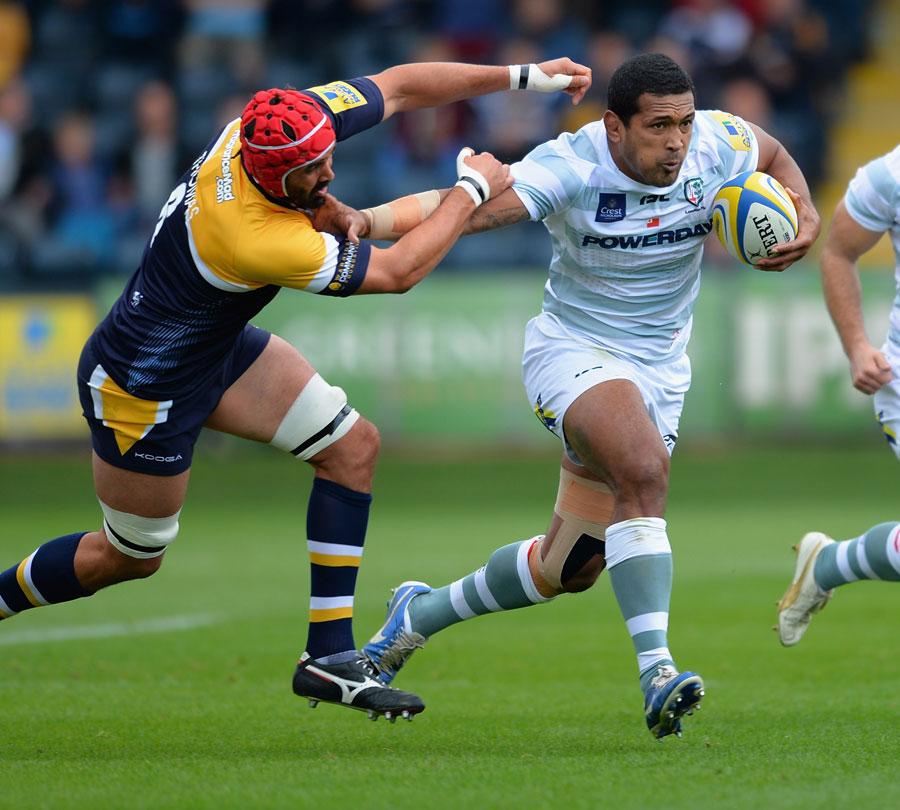 London Irish's Chris Hala'ufia fends off Worcester's Jonathan Thomas