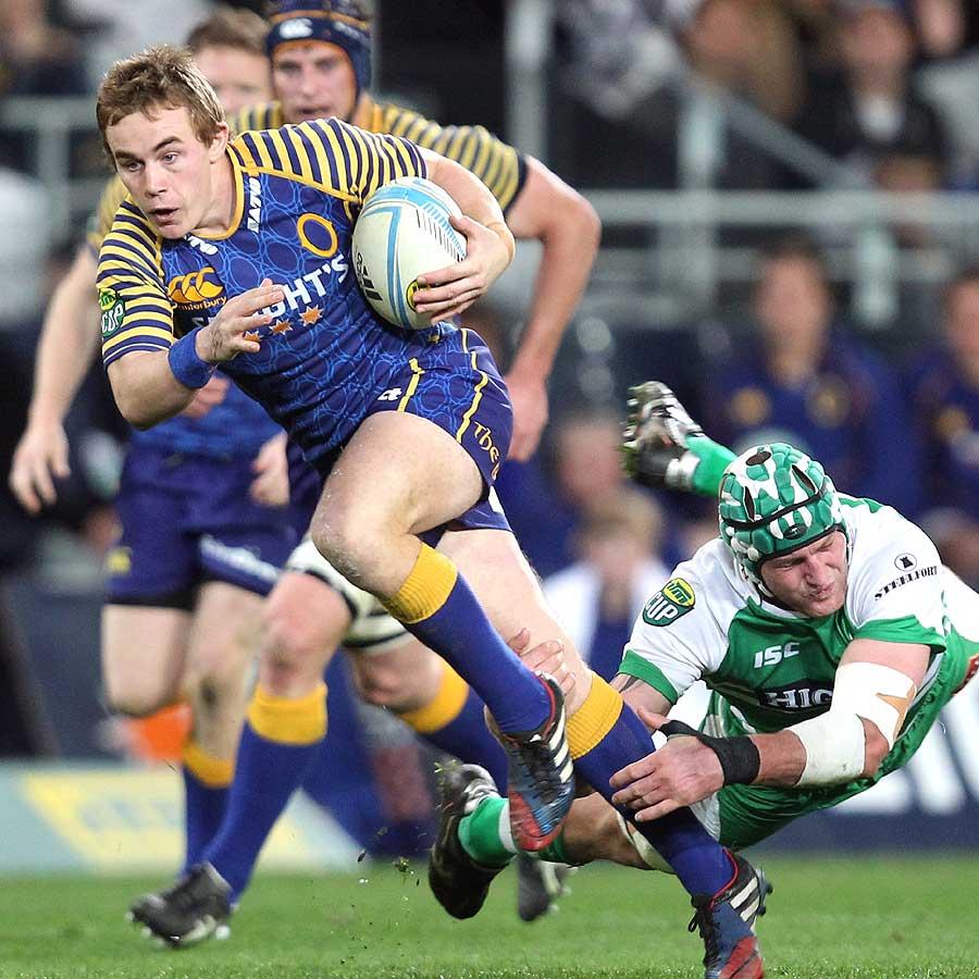 Otago's Hayden Parker bursts through a tackle