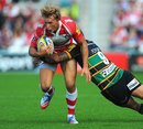 Gloucester's Billy Twelvetrees is stopped in his tracks