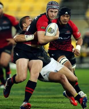 Canterbury fly-half Tyler Bleyendaal is tackled by Ardie Savea, Wellington v Cantebury, ITM Cup, Westpac Stadium, Wellington, September 21, 2013