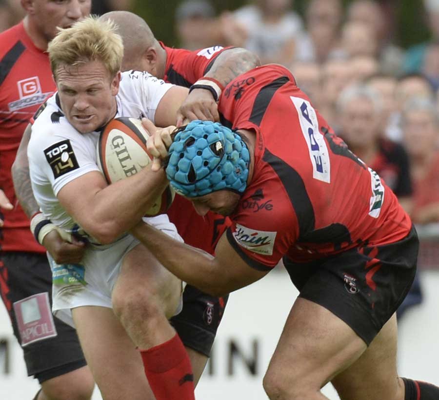 Toulon's Michael Claassens is halted by the Oyonnax defence