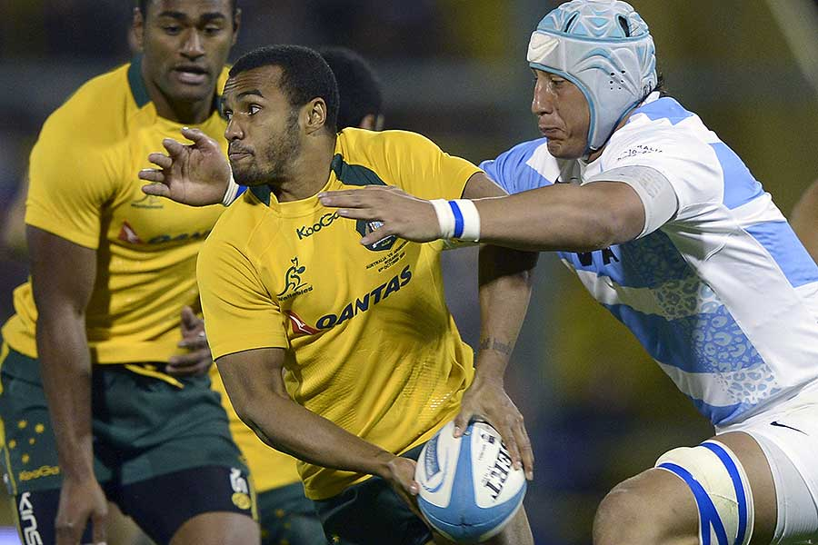 Argentina's Patricio Albacete tackles Australia's Will Genia