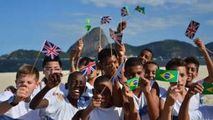 Children enjoy the beach rugby, Rio de Janeiro, Brazil, October 10, 2013