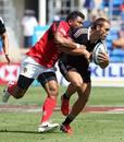 New Zealand's Joe Webber is tackled by Tonga's Tasi Ma'u