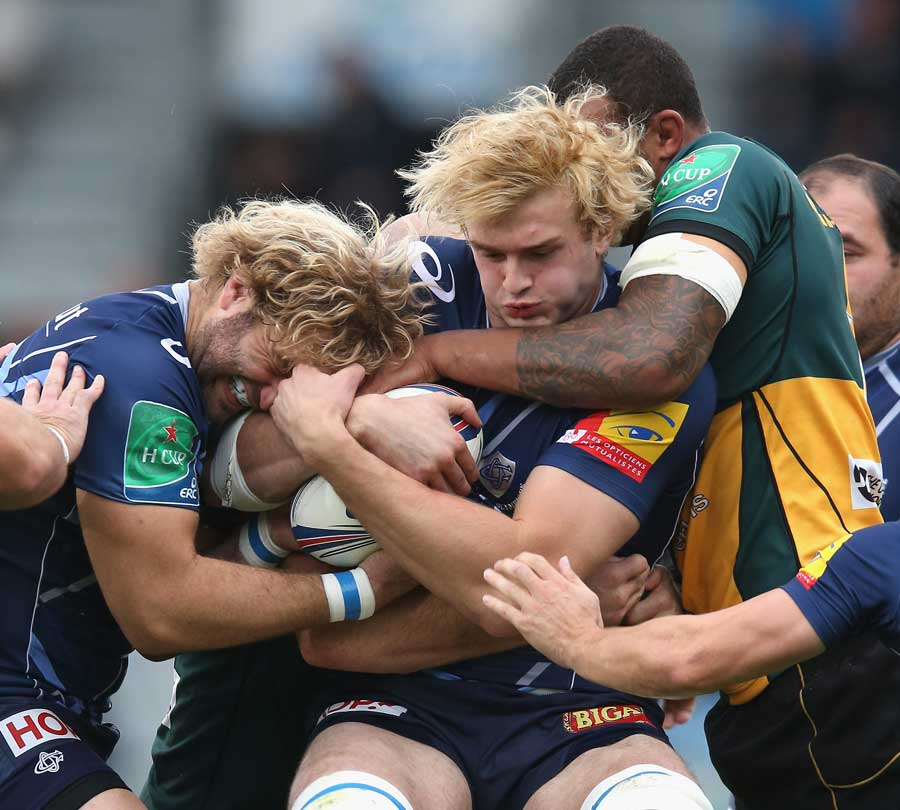 Castres' Richie Gray is tackled by Courtney Lawes
