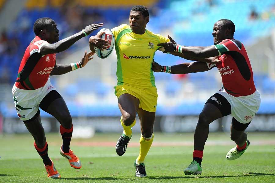 Australia's Shannon Walker breaks through Kenyan defence
