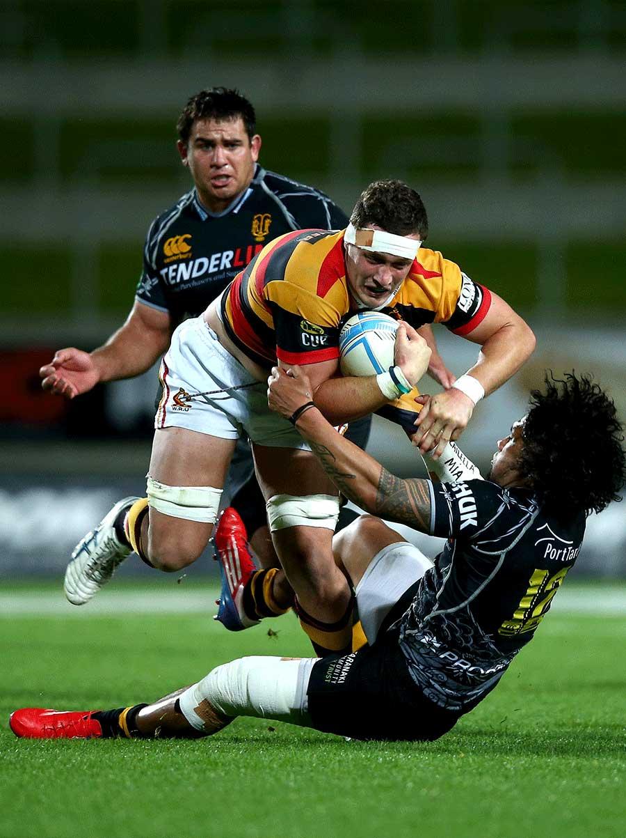 Waikato's Rory Grice is tackled by Taranaki's Isaia Tuifua