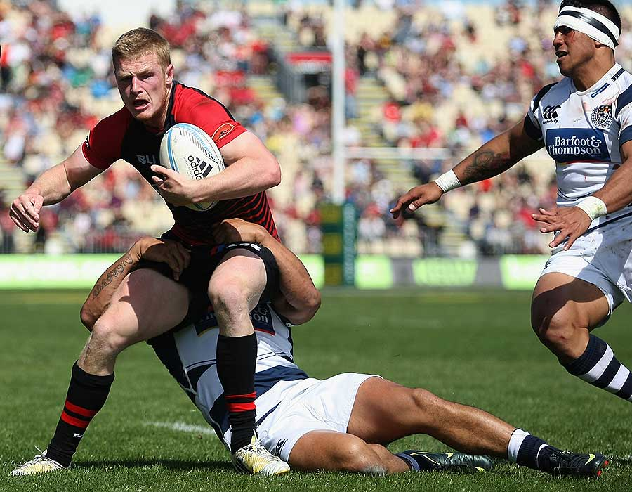 Canterbury's Johnny McNicholl steps out of the tackle of Auckland's George Moala