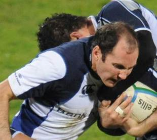 Leinster fullback Girvan Dempsey grapples for the ball with a Castres player during their Heineken Cup match at the Stade Pierre Antoine, December 12 2008