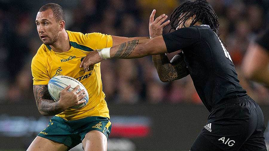 Australia's Quade Cooper palms off Ma'a Nonu, New Zealand v Australia, Bledisloe Cup, Forsyth Barr Stadium, Dunedin, October 19, 2013