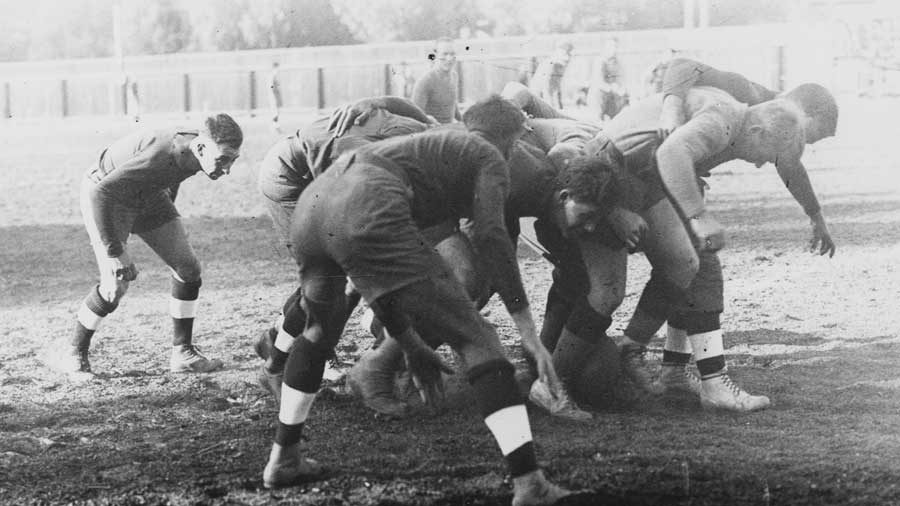 Players of the University of Southern California Trojans rugby team compete against the Manual Arts High School