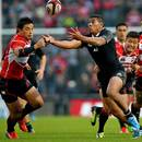 New Zealand's Charles Piutau collects a loose ball to score his first try