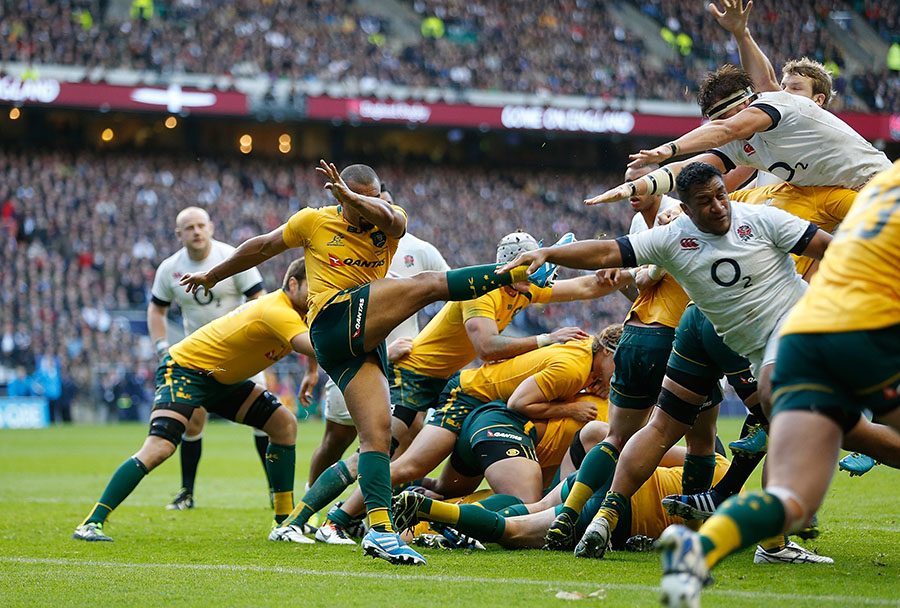Will Genia's kick is charged down by Tom Wood to allow Robshaw to cross for England