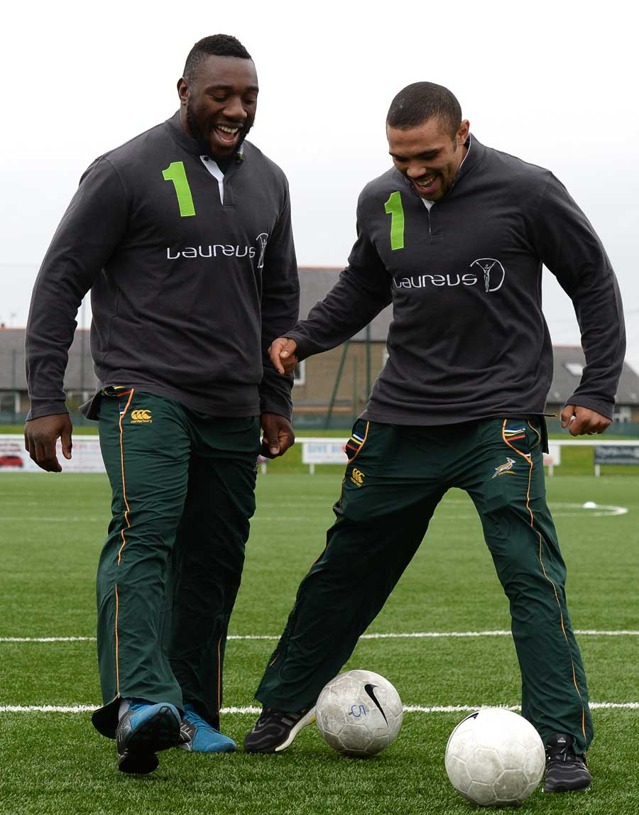 South Africa's Tendai Mtawarira and Bryan Habana try out a spot of football
