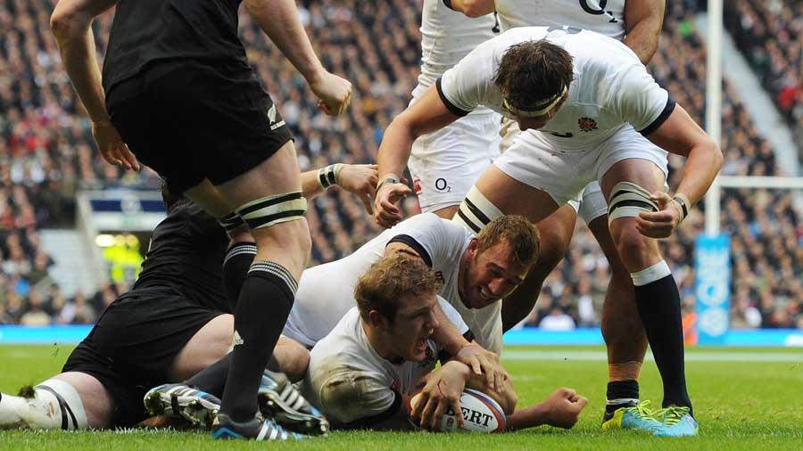 England's Joe Launchbury grabs a try
