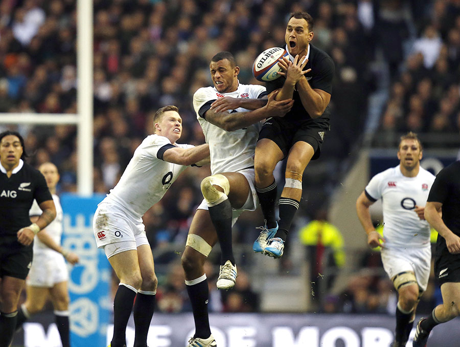 New Zealand's Israel Dagg contests a high ball with England pair Courtney Lawes and Chris Ashton
