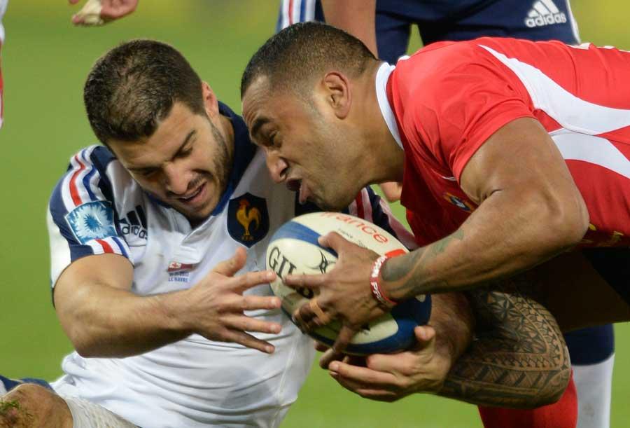 France's Sofiane Guitoune vies for the ball with Tonga's winger Fetu'u Vainikolo