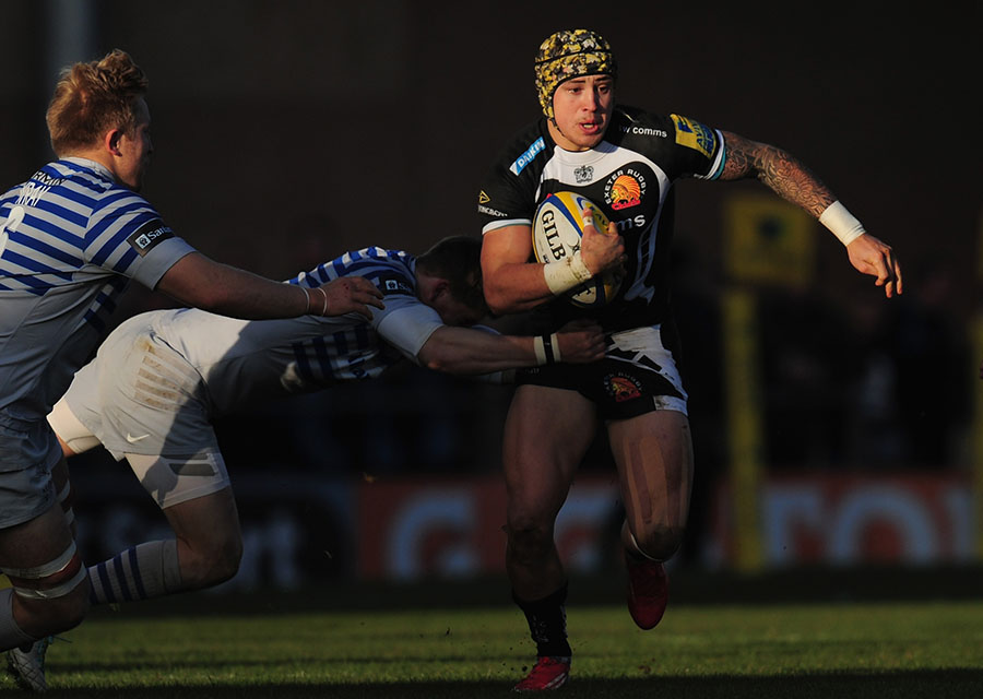 Exeter's Jack Nowell tries to escape the attention of Sarries hands