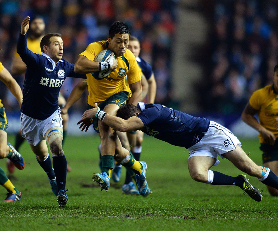 Grieg Laidlaw and Tommy Seymour try to stop Australia's Chris Feauai-Sautia in his tracks