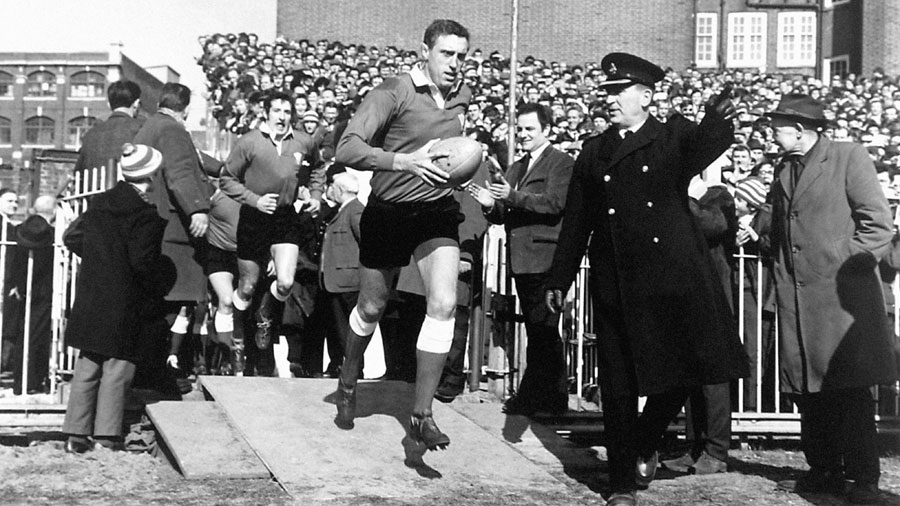 Wales captain Brian Price leads his team out
