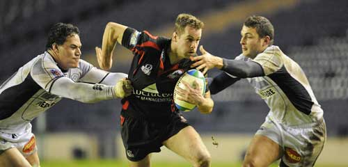 Edinburgh's Chris Paterson makes a break