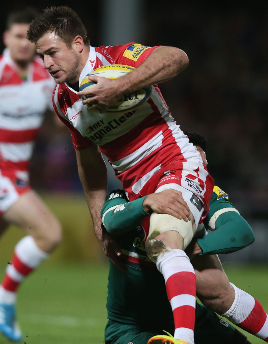 Gloucester's Henry Trinder carries forward against Leicester