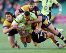 Northampton's Luther Burrell tries to escape the attentions of three Worcester Warriors