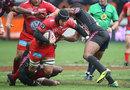 Juan Smith drives through tackles
