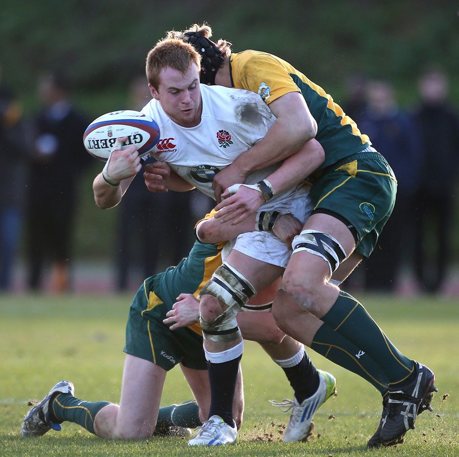 James Chisholm Is Tackled During The Under-18