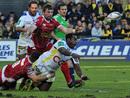 Clermont's Sitiveni Sivivatu offloads under heavy Scarlets pressure