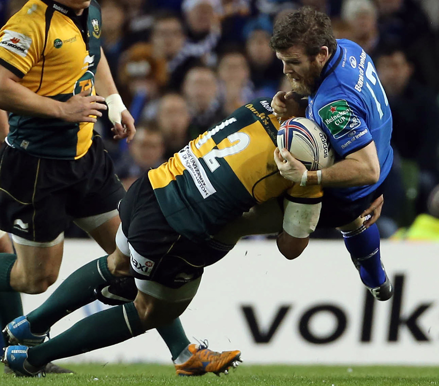 Luther Burrell sends Leinster's Gordon D'Arcy flying in Dublin