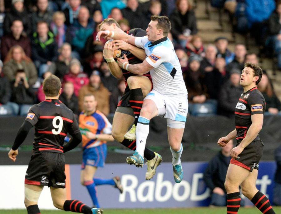 Stuart Hogg rises to challenge for the ball